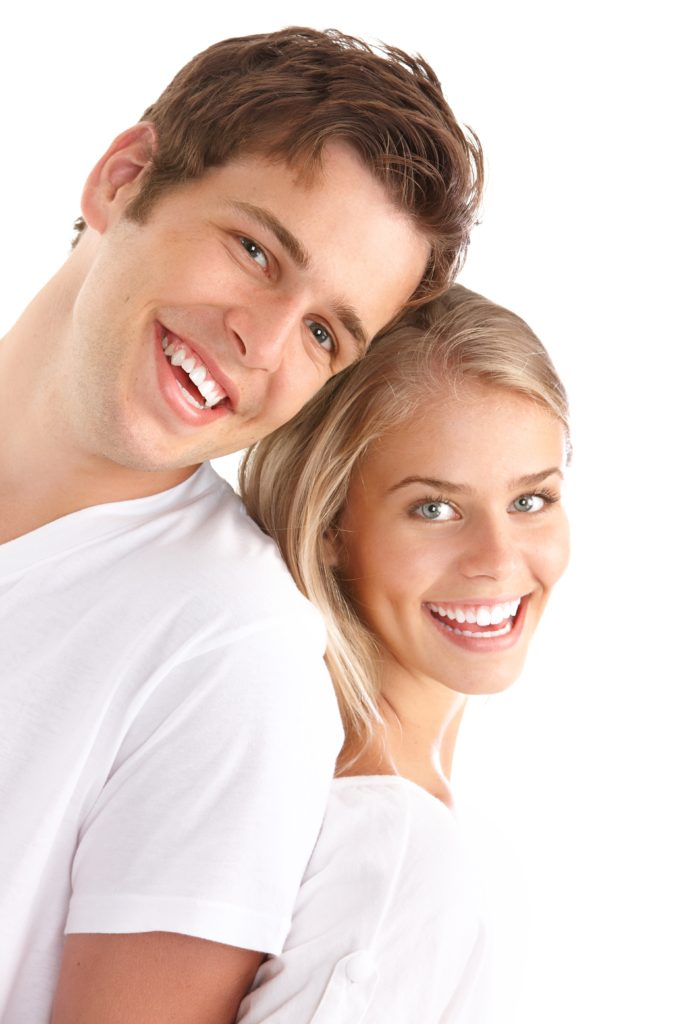 Two teens happy with their cosmetic dentistry