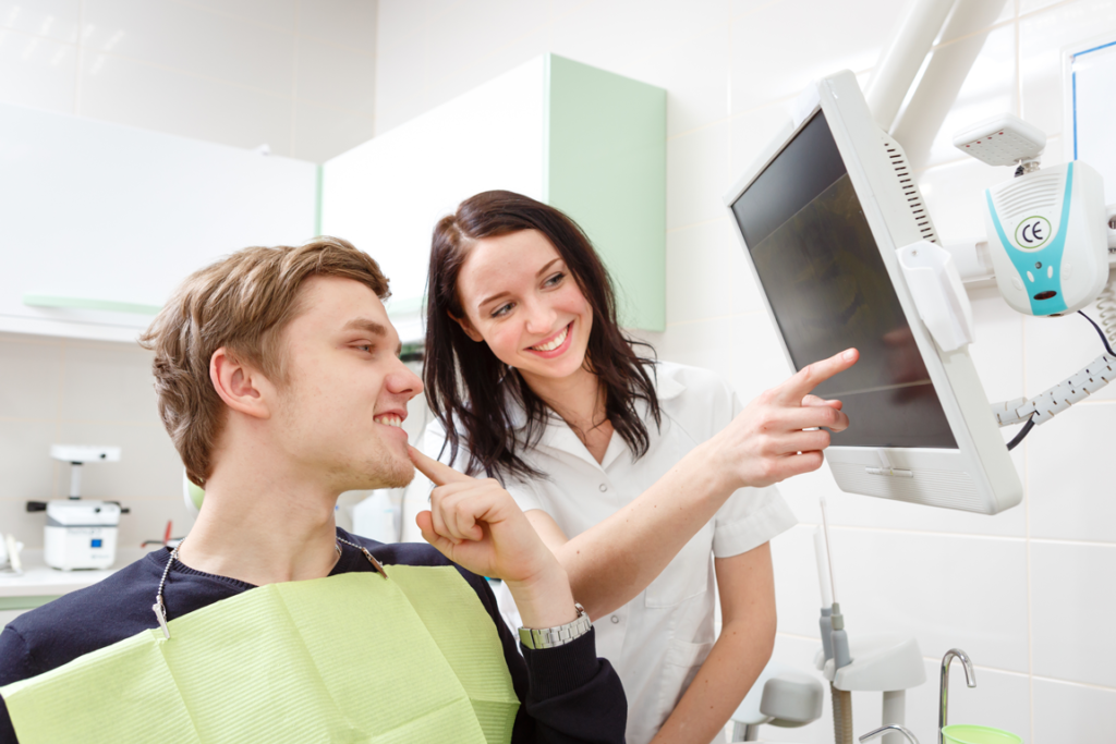 Patient discussing results with general dentist